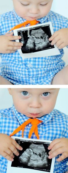 Cute idea for first birthday picture, baby holding his sonogram photo