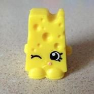 Cheezee (Shopkins 1-065, 1-073) Chee Zee is a yellow block of Swiss cheese. His variant is colored blue. Chee Zee is a common Dairy Shopkin from Season One.
