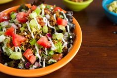 """Raw vegan taco salad!    Taco """"meat""""  - Walnuts, cumin, chili powder - pulsed in processor  Nut cream sauce - cashews or macademias soaked and blended with lemon (I use lime) juice and water."""