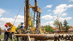 Geothermal Drillers at Work.\nDrilling geothermal well for a residential geothermal heat pump. Workers lifting a drill pipe on a drilling rig. Water Well Drilling, Drilling Rig, Heat Pump, Photo Editing, Royalty Free Stock Photos, Fair Grounds, Wellness, Pictures, Image