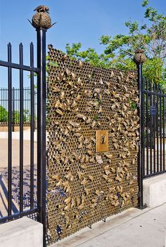 A beautifully detailed gate by Christopher Russell, located in Sunset Park Brooklyn and inspired by honeycomb and beehives.