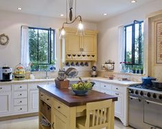 Homey Kitchen gain cooking and eating space with a kitchen island | homey