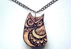 A hand carved owl necklace with a pyrography (wood burning) design. I carve these from beech and apply a lacquer to protect the wood. They are