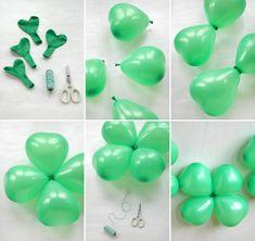 trèfles de ballons groupés deux par deux, ballons verts rassemblés en trèfle à quatre feuilles
