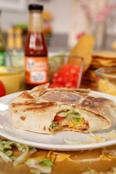 This a home-hacked version of Taco Bell's Crunchwrap: a burrito-taco hybrid. Inside the grilled flour tortilla is a tostada shell, ground beef, beans, nacho cheese, lettuce, tomato, guacamole, and salsa!