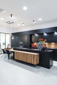 "Black adds a hit of posh style to any cooking Space . For a less Stark ,but equally chic option, consider""almost Black"" colors that are… Modern Kitchen Interiors, Luxury Kitchen Design, Kitchen Room Design, Contemporary Kitchen Design, Kitchen Cabinet Design, Home Decor Kitchen, Interior Design Kitchen, Kitchen Furniture, Kitchen Cupboards"