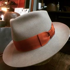 A vintage 125 fur felt fedora. The raw good for this hat was made at the Mallory hat factory in 1952. The Vintage 125 weigh 3 oz. Fully finished, that is less than your phone. It is finished with a vintage 1930's rust tone grosgrain ribbon.