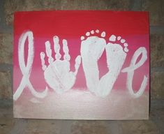 Make a Mother's Day craft with paint and your kid's hands and feet.