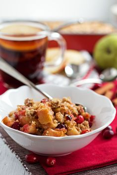 This healthy Skinny Holiday Fruit Crisp recipe is awesome! A filling with apples, pears and cranberries topped off with oat crunch! Less sugar and butter!