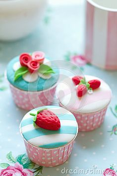 Cupcakes decorated with fondant strawberries and roses