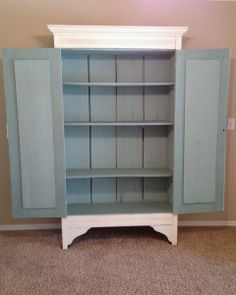 Antique armoire painted with Annie Sloan Chalk Paint in Old White and Duck Egg Blue