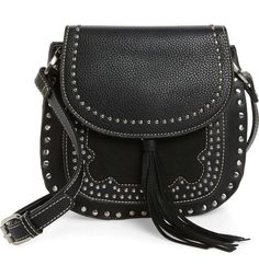 Shiraleah Skylar Faux Leather Saddle Bag in black and silver | A swingy tassel and a vintage-saddlebag silhouette further the boho-chic style of a compact faux-leather bag, finished with polished studs and equestrian-inspired hardware. Nordstrom.