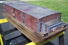 Boats and barges in garden railroads with the space for water features you can create a wharf with our plans.