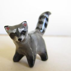 animal figurine raccoon