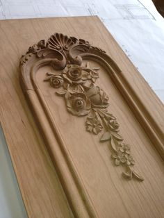 Hand carving pilaster in Louis XV cherry wood library in production. Designed & manufactured by Auffrance.