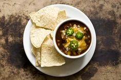 A blend of ancho, guajillo, and pasilla chiles form the spicy, earthy base of this Texas chili that uses shredded turkey instead of the traditional beef. Homesick Texan, Turkey Chili, Soup And Sandwich, Tex Mex, Soups And Stews, Holiday Recipes, Yummy Food, Delicious Recipes, Spicy