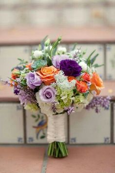 White & Green Hydrangea, Lavender Roses, Lisianthus, Lilac, Purple Lisianthus, Coral/Orange Roses, Small Coral Garden Roses, Green Succulent, White Garden Roses, + Greenery/Foliage, Tied With White Satin Bouquet Wrap·····