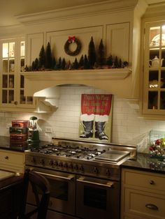 Love this kitchen hood with shelving