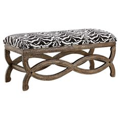 Pairing a curving openwork base and exotic zebra-print upholstery, this eye-catching bench offers bold style for your foyer or the foot of your bed....