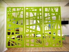 Suspended dividing screens partition off an area in an office adding a contemporary feature to the space.