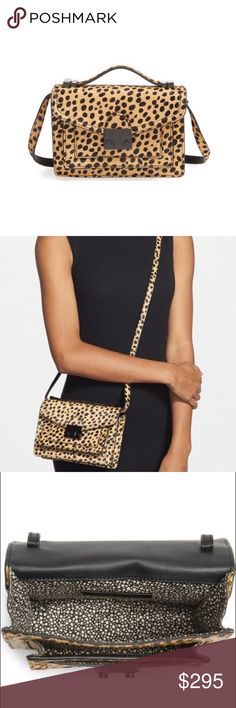 "Loeffler Randall Calf Hair Mini Rider Crossbody A spot-on balance of uptown chic and downtown edge makes this smaller version of Loeffler Randall's popular Rider bag a must-have. Sleek black lacquered hardware contrasts beautifully with lush calf hair in a cheetah print, while a top handle and optional, adjustable strap allow for styling options.  Push-lock flap closure. Adjustable crossbody strap. Two exterior slip pockets beneath flap. Exterior back slip pocket. 8""W x 5 ½""H x 2 ¼""D. 11""…"