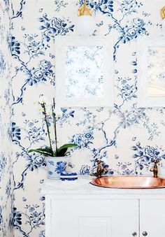 Bathroom Bliss. Blue and white floral wallpaper and copper sink.