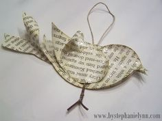 love. recycled book pages used to make bird ornaments