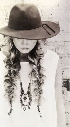 Messy braids and a boho hat