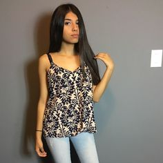 Super chic blouse with flowery print!! Super cute and hardly worn blouse. Spaghetti strapped with cute back strap design. Colors are cream and dark purple. Caramela Tops Blouses