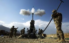 Soldiers from Alpha Battery of the 2nd Platoon, 2-77 Field Artillery fire a 155mm Howitzer towards insurgent positions at FOB Joyce in Afghanistan's Kunar Province June 25, 2012.  REUTERS/Lucas Jackson