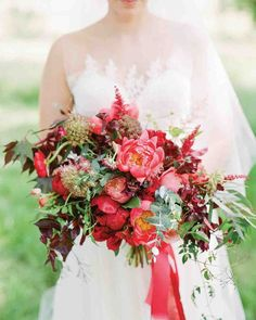 Pretty in Pink Wedding Bouquet Ideas | Martha Stewart Weddings - Coral and red charm peonies and roses made this deep-hued Hope Flower Farm bouquet a winner.