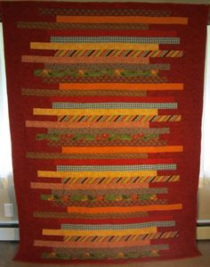 Red Jelly Roll Quilt by Nancy Isgrig