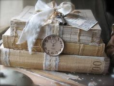 antique books add character - lovely for a table number  (original source unknown)