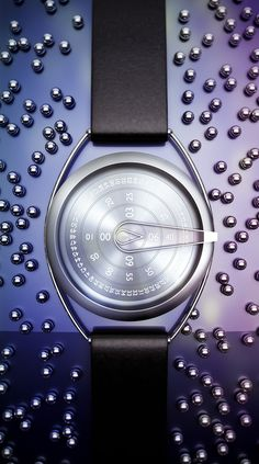 CIRCUL BY Ivan Schuler is the concept design for a minimal circularwatch.  The numbers are the movingelements.    Hours, minutes and secondswithin 3 different disks turn around.  Allthe pieces made in steel.