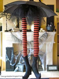 Whimsical witch legs made from an old umbrella.