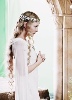 Galadriel is one of the Royal Elves, and is also known as Lady of Lórien, and Lady of the Golden Woods. She has the gift of insight  into others minds, and saw the weakness in Boromir. She was well over 7000 years old when she set sail over the Great Sea with Elrond, Gandalf, and the ring bearers, marking the end of the Third Age.