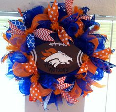 Custom made Denver Broncos Wreath! Designs by Sammy ships nationwide! Find us on Facebook or email us at designsbysammywithlove@gmail.com to order your custom designed wreath today!