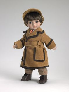 ©Mary Engelbreit Warm and Cozy 2007 Robert Tonner DRESSED DOLL T7-AEDD-01 Original price: $99.99 OUTFIT ONLY T7-AEOF-01 LE400 Originally Sold For $59.99 Corduroy trench coat with faux suede trim over cotton shirt and tie with tweed pants; includes hat, socks and shoes.