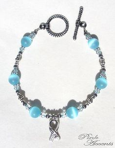 Prostate Cancer Awareness: Light Blue Glass, Swarovski Crystal, and Sterling Silver Plated Bracelet, 8.00 inches.  30% of your purchase price goes directly to the Prostate Cancer Research Institute, to improve the quality of men's lives by supporting research and disseminating information that educates and empowers patients, families and the medical community.