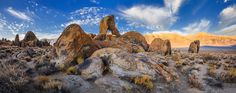 """Boot Arch with Sierra Nevada an background at Sunrise.  Alabama Hills. Alabama Hills are a """"range of hills"""" and rock formations near the eastern slope of the Sierra Nevada Mountains in the Owens Valley, west of Lone Pine in Inyo County, California. Though geographically considered a range of hills, geologically they are a part of the Sierra Nevada mountains.  Stitched panorama - 3 horizontal frames  Used  24mm lens. Мои Фототуры по всему миру на www.fotowalk.com"""