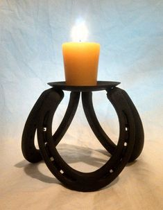 hand crafted horseshoe candle holder for BethItems similar to hand crafted horseshoe candle holder on EtsySome cool horse shoe candle holder ideasDiscover thousands of images about Put together a rustic candle holder from old horseshoes & reclaimed w Welding Art Projects, Welding Crafts, Metal Projects, Metal Crafts, Diy Welding, Blacksmith Projects, Welding Ideas, Horseshoe Projects, Horseshoe Crafts