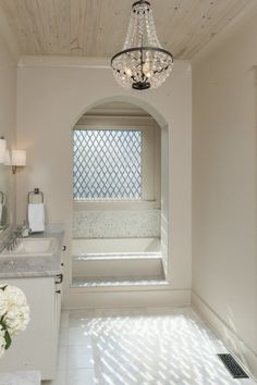 Christopher AI alcove bath with a great chandelier