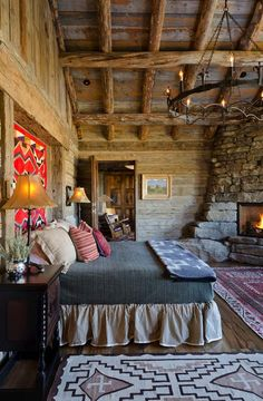 Simple Rustic Cabin Bedroom - love the western theme and look at that fireplace & chandler!