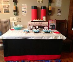 Titanic-themed birthday party; decorated dining table spray glued red and black fabric while using red poster board and black trash bags for pipes. Was great project for me and 8-yr old stepson to do together for his party