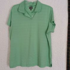 Adidas climacool light green polo Never worn, but no tags, just been hanging in the closet, very comfortable, I just don't wear polos... I have others listed and will bundle. Adidas Tops