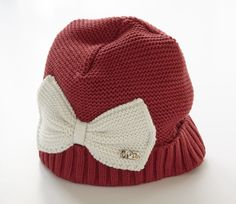 A-Dee red winter hat with cream bow detail.