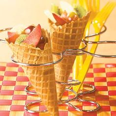 Fruit Sundae Cones: 3/4 cup cut-up strawberries 3 cups cut-up fruits, such as apples, bananas, cherries, seedless red grapes, kiwifruit, plums, and/or peaches 6 large waffle cones 1/4 cup toasted coconut (optional) 1.Place strawberries in a blender container; cover and blend until smooth. Place desired fruit in bowl; gently toss together. Spoon fruit into cones. Drizzle with the strawberry puree. If desired, top with coconut. Makes 6 cones.