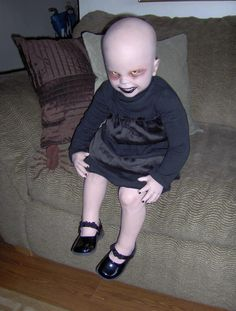 This is creepy, but if I have a child I want it to dress like this for Halloween.
