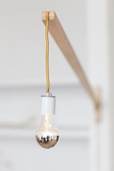 Same thing goes if you have any post and beam in your ceiling just wrap a cord light around it and plug 'er in!
