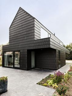 So Neighbors, you want a pitched roof? TAKE THAT! Modern Home - Pitched Roof and Shingles